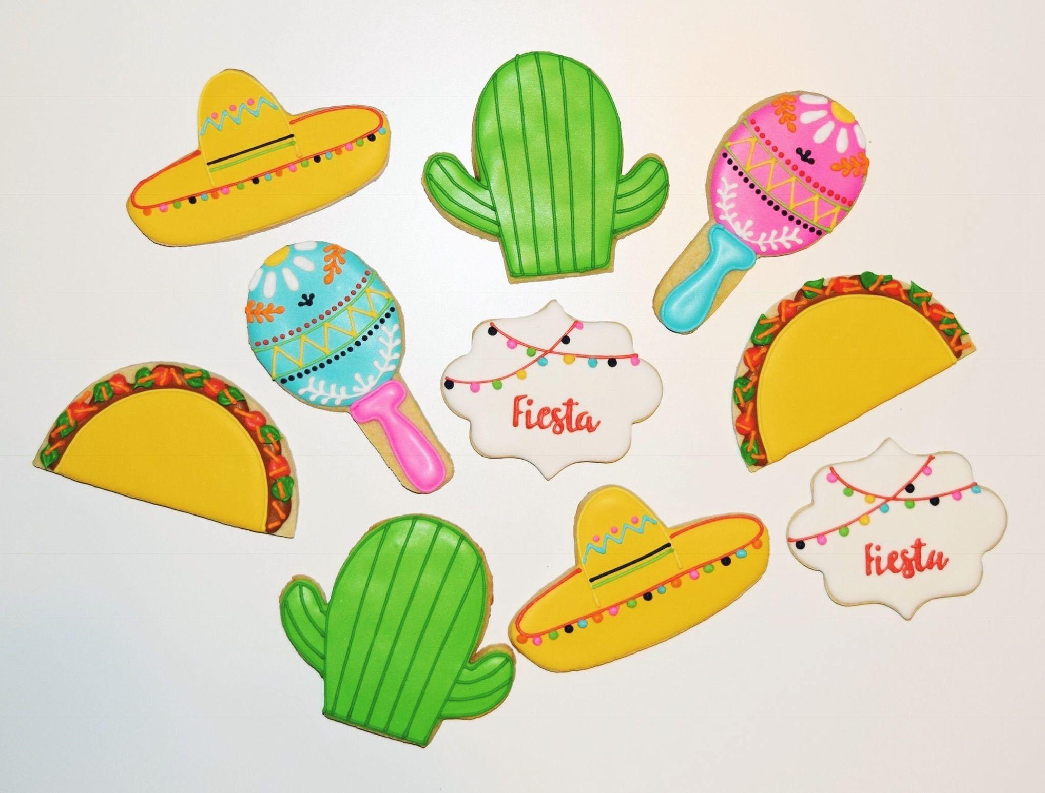 Fiesta-themed decorated cookies #tacocookies #fiestacookies #cactuscookies