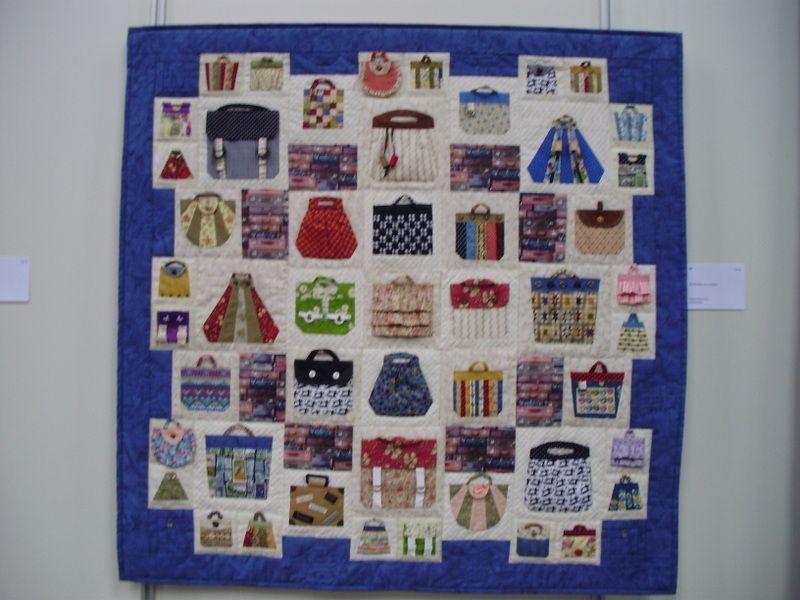 Een quilt met allemaal tasjes
