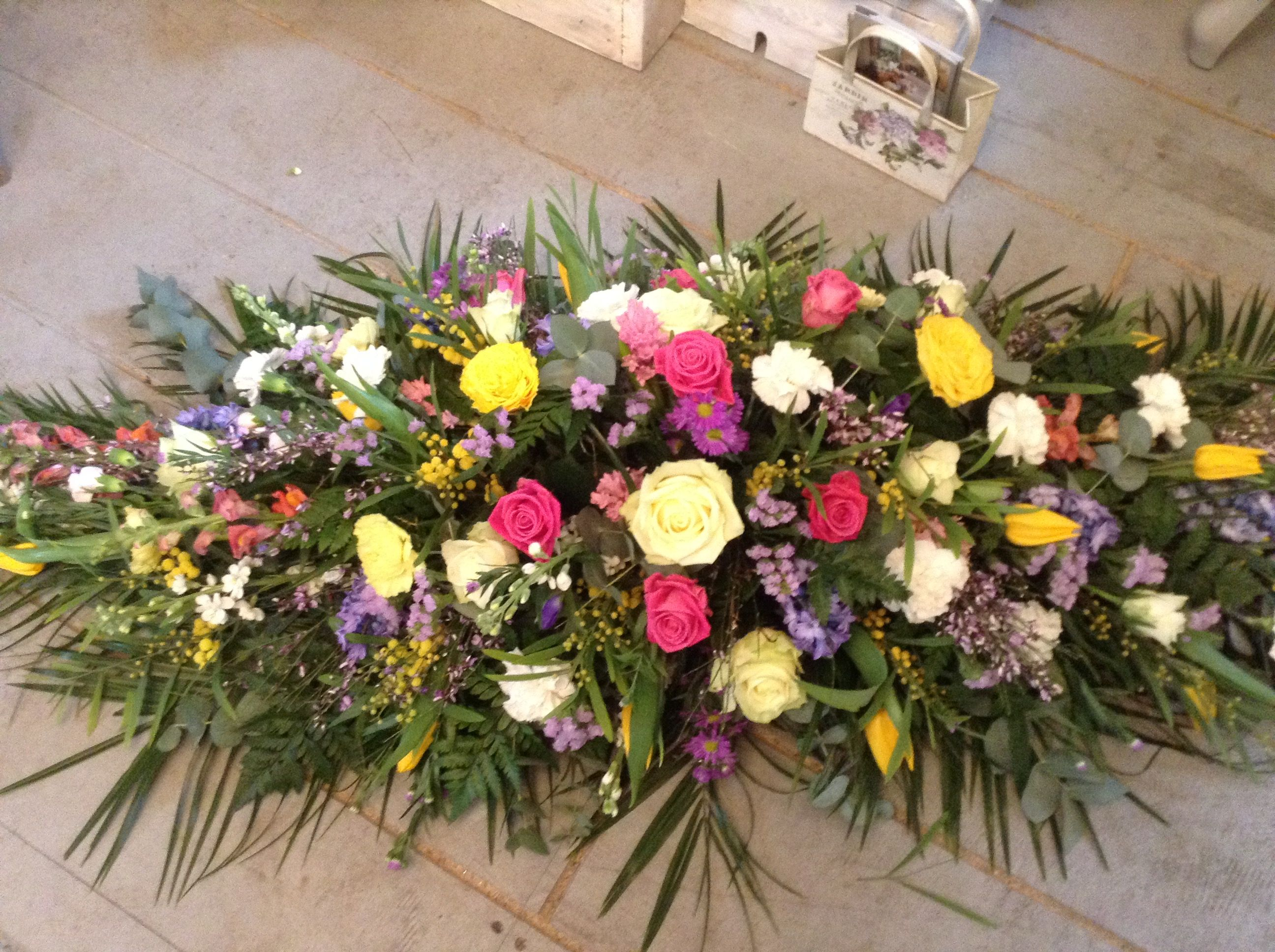 Bright and colourful spring coffin spray casket funeral tribute bright and colourful spring coffin spray casket funeral tribute thefloralartstudio izmirmasajfo