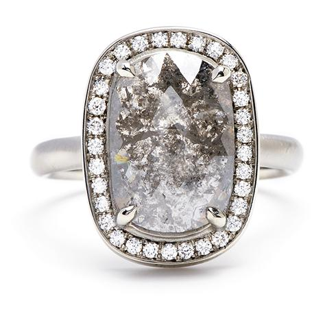 Boldly fascinating, this ring features a rose-cut gray diamond surrounded  by a round