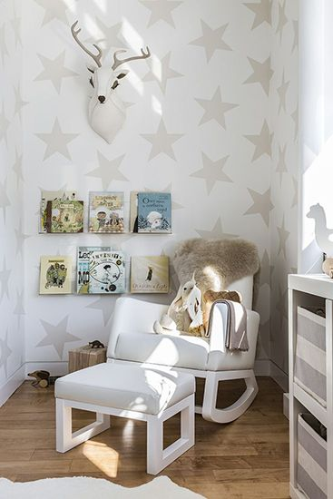 Since hanging art isn't an option over the beds, opt for decals. I love the look of this wall of stars, and it definitely works for boy and girl.