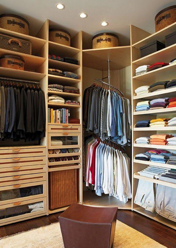 A Rotating Stainless Steel Clothing Rack Maximizes Corner Closet Space.
