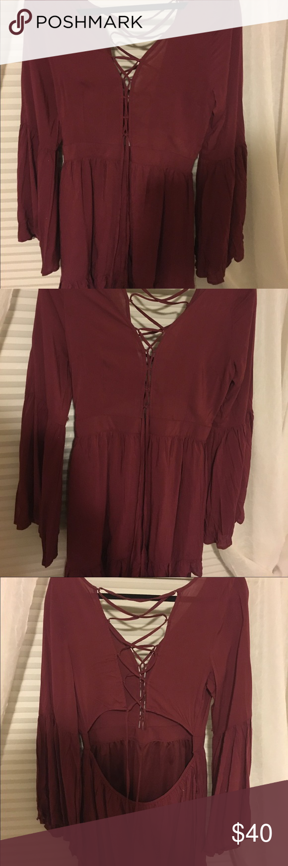 Unworn Burgundy romper Lace up front and back, with ruffles on sleeves and bottom. Dresses Long Sleeve