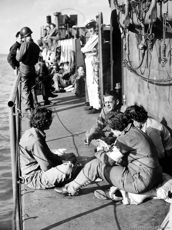 Though Allied invaders held all the aces in an earlier crossing of the same waters, these army nurses spanning the English Channel aboard a Coast Guard-manned infantry landing craft, seem to be holding a few cards themselves. Bound for France to administer to American wounded, the nurses relax on deck with a game of bridge. (LCI - LCT - nurses - playing cards )
