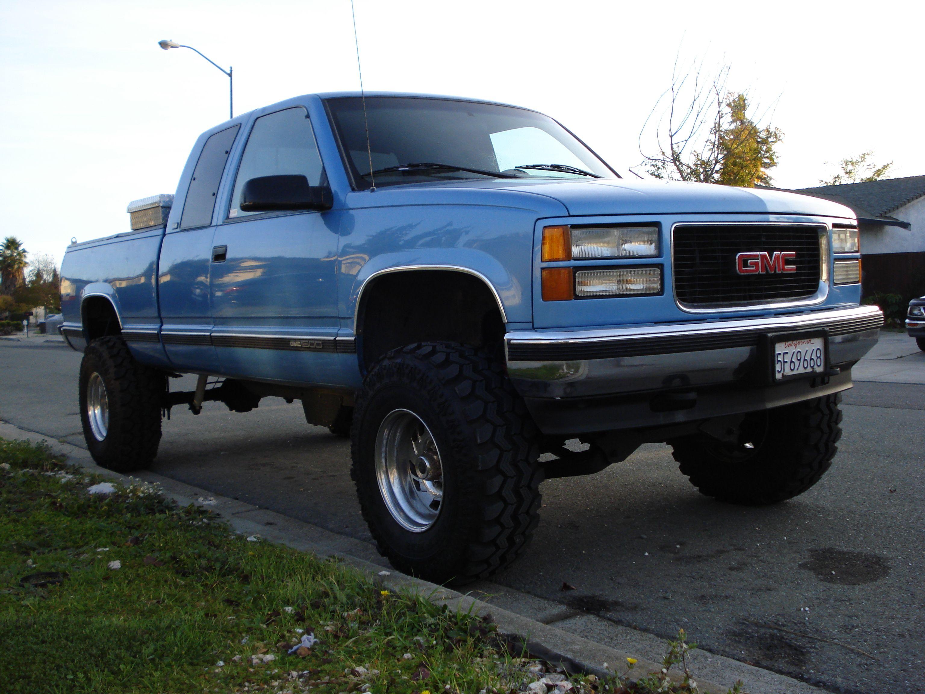 Lifted gmc sierra truck front hood view