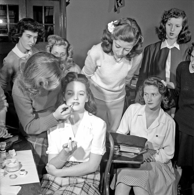 1940s photo1940s fashionA demonstration of the correct procedure in applying street makeup in a home management class at Woodrow Wilson High School street makeup 1940s vi...