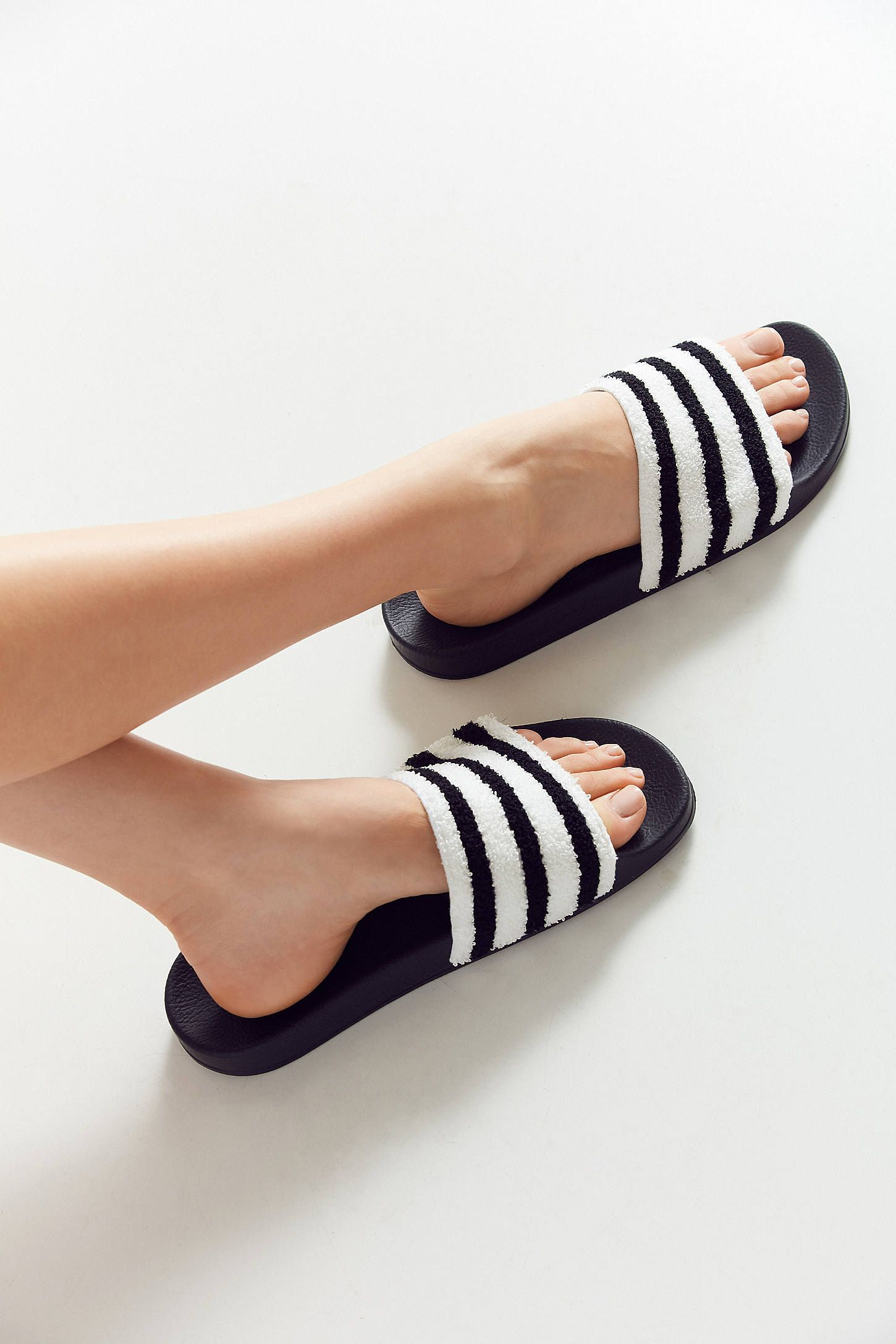 5a157a49fbf886 Shop adidas Originals Adilette Slide at Urban Outfitters today. We carry  all the latest styles