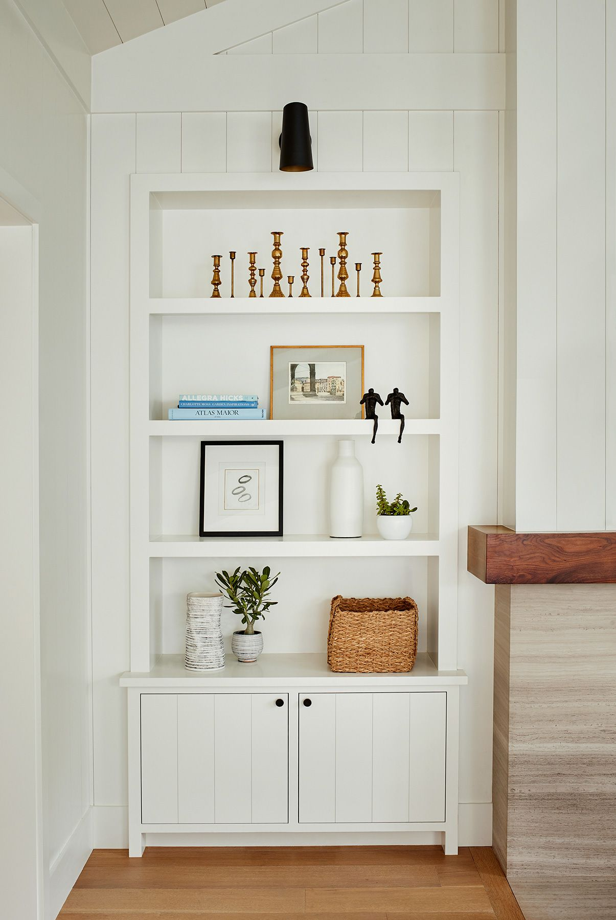 White Vertical Shiplap Walls Tongue And Groove Detail On The Cabinetry Matte Black Hardware And Sconces Over The Interior Home Design Decor Interior Design