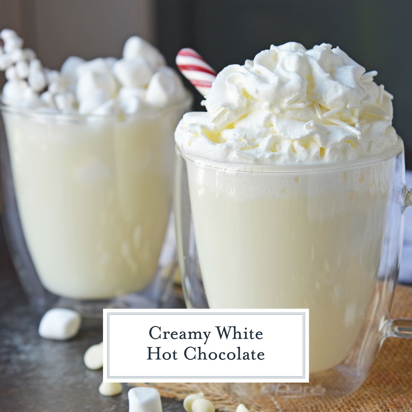 Homemade White Hot Chocolate is the perfect drink for warming up on cold days. White chocolate hot chocolate is delicious, quick and easy to make! #whitehotchocolaterecipe #whitehotcocoa www.savoryexperiments.com #hotchocolatebar