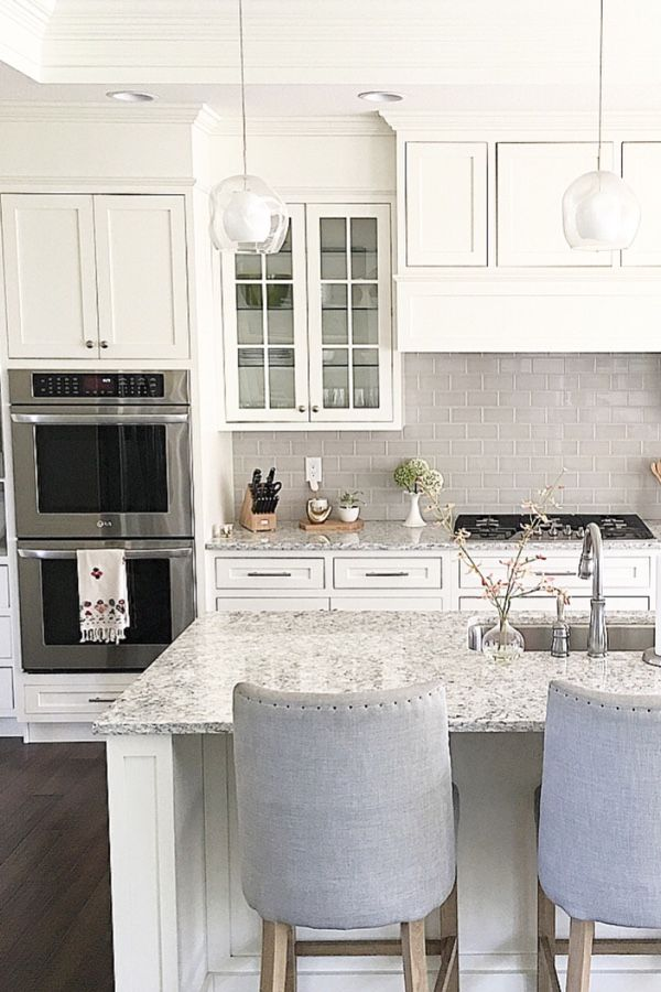 White Shaker Cabinets And Soft Grey Subway Tile Backsplash. LG Viatera  Quartz Countertop In Everest.