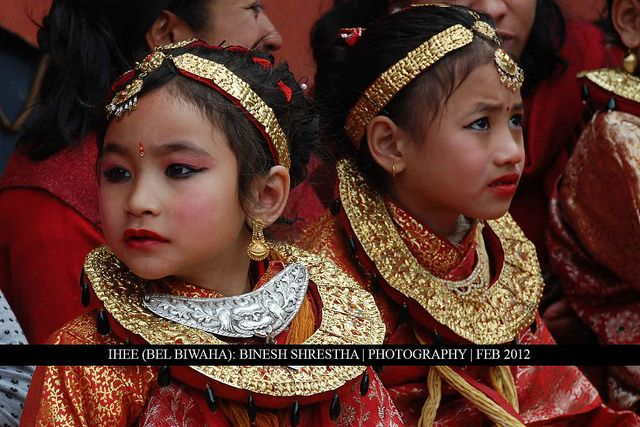 Ihee (Bel Biwaha):  A girl in traditional attire during her Ihee (Bel Biwaha) Ceremony. This is a newari culture in which every girl does her 1st wedding with BEL (Wooden Apple), This ritual is usually done during the age of 5 to 9 years old.  The 2nd  model gelin