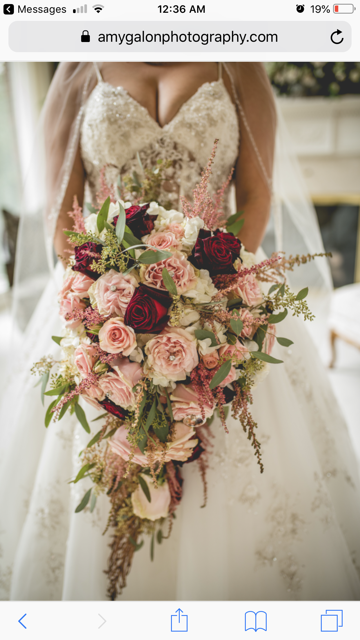 Cascading bouquet burgundy and blush wedding bride