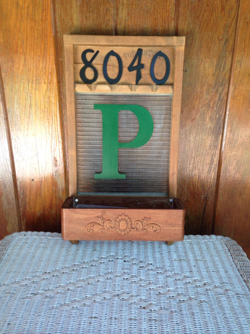 """Using an antique washboard and one antique sewing cabinet drawer, I created a welcome sign with our house number and monogram (I purchased the letter """"P"""" at my local crafts store and the house numbers at my local hardware store).  I will fill the drawer space with seasonal decor and/or flowers."""