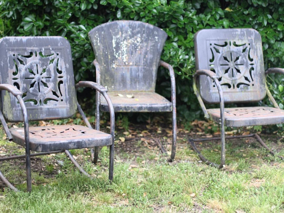Mid-century vintage metal lawn chair. Buntings bookmarking unknown