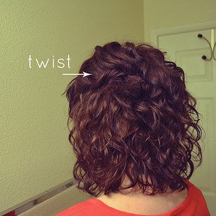 Twist and pin back the front sections of a curly bob.