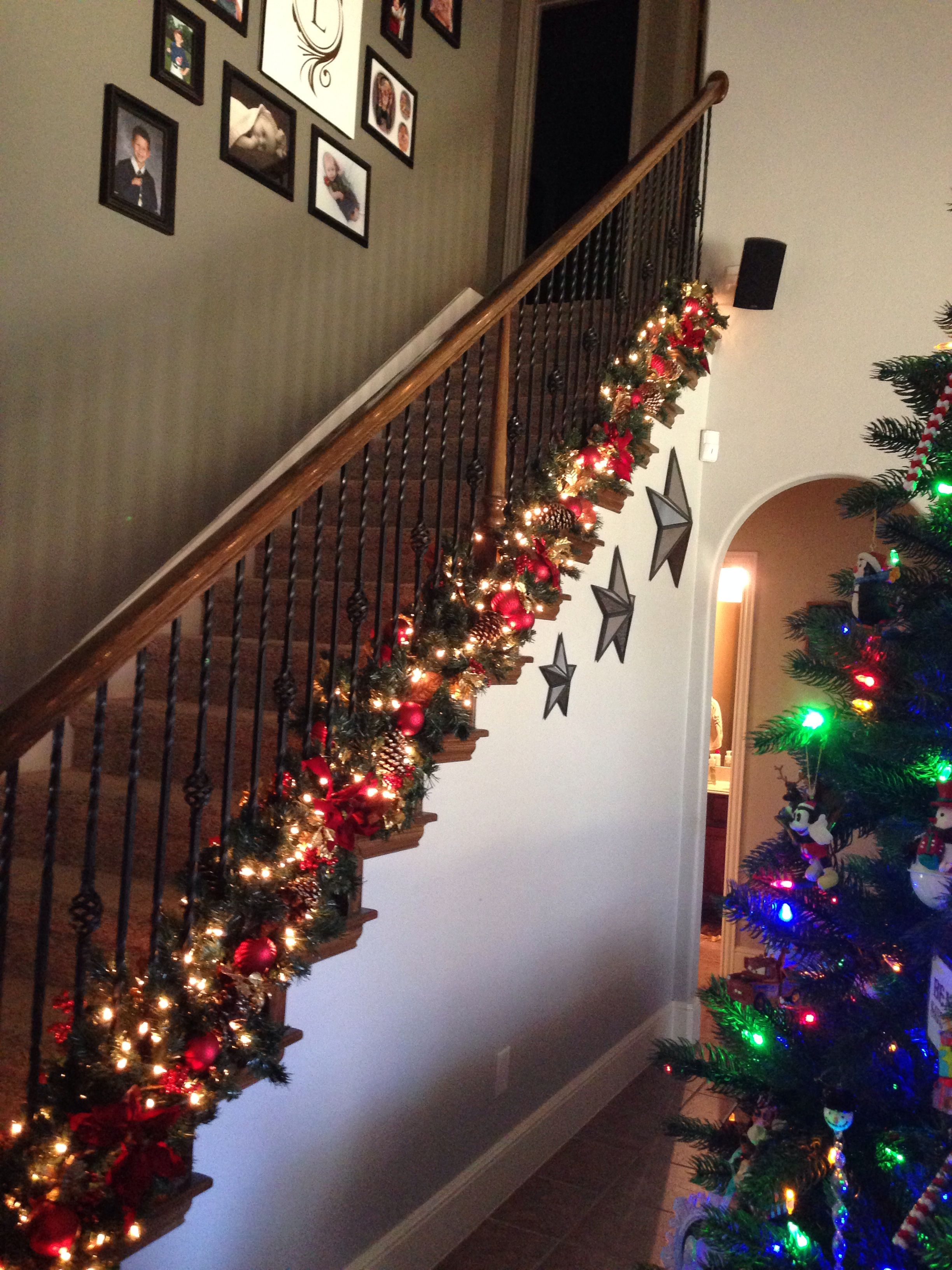 love the garland at bottom of banister to keep hand rail free for kids and guest - Christmas Decorations Staircase Hand Railing