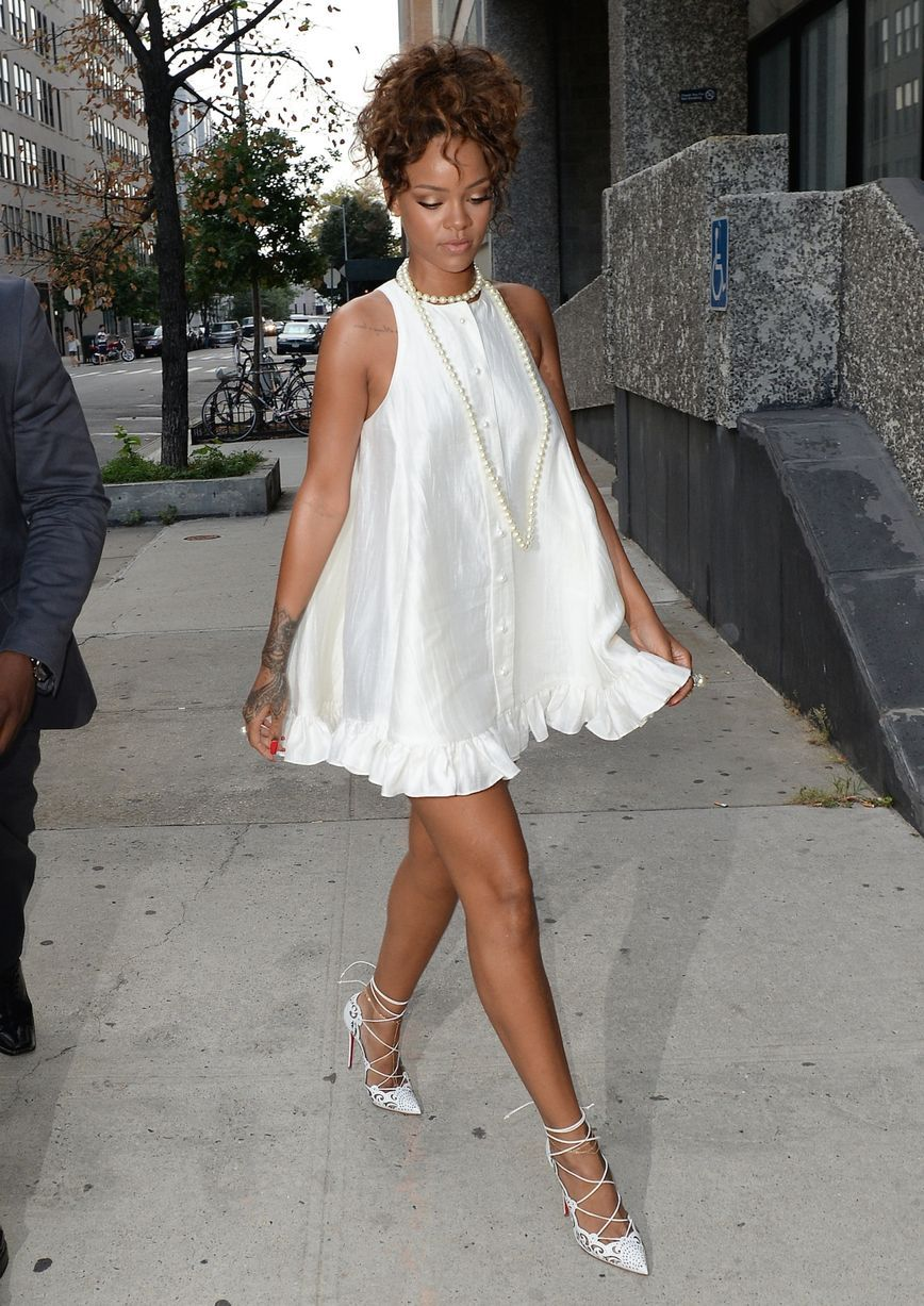 4a3b1969a80 Rihanna wears cute baby doll dress and looks like a sexy version of ...