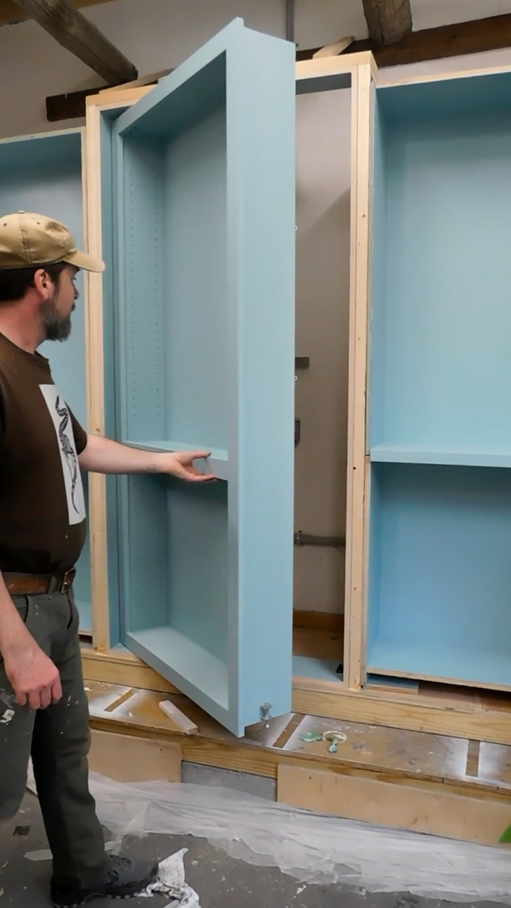 Testing the secret door in a bookcase we're building in Asheville, NC