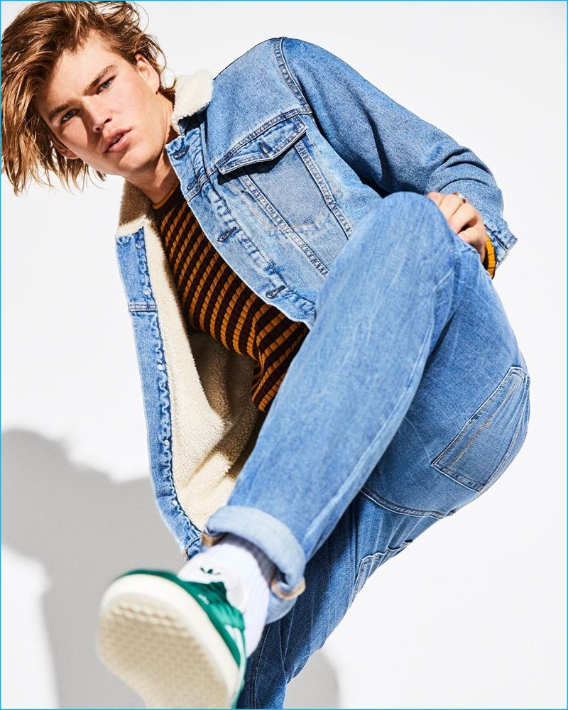 cbd0442286c3 Doubling down on denim, Jordan Barrett wears a New Look denim jacket with  Levi s jeans. The leading model also sports a striped sweater from Just  Cavalli ...