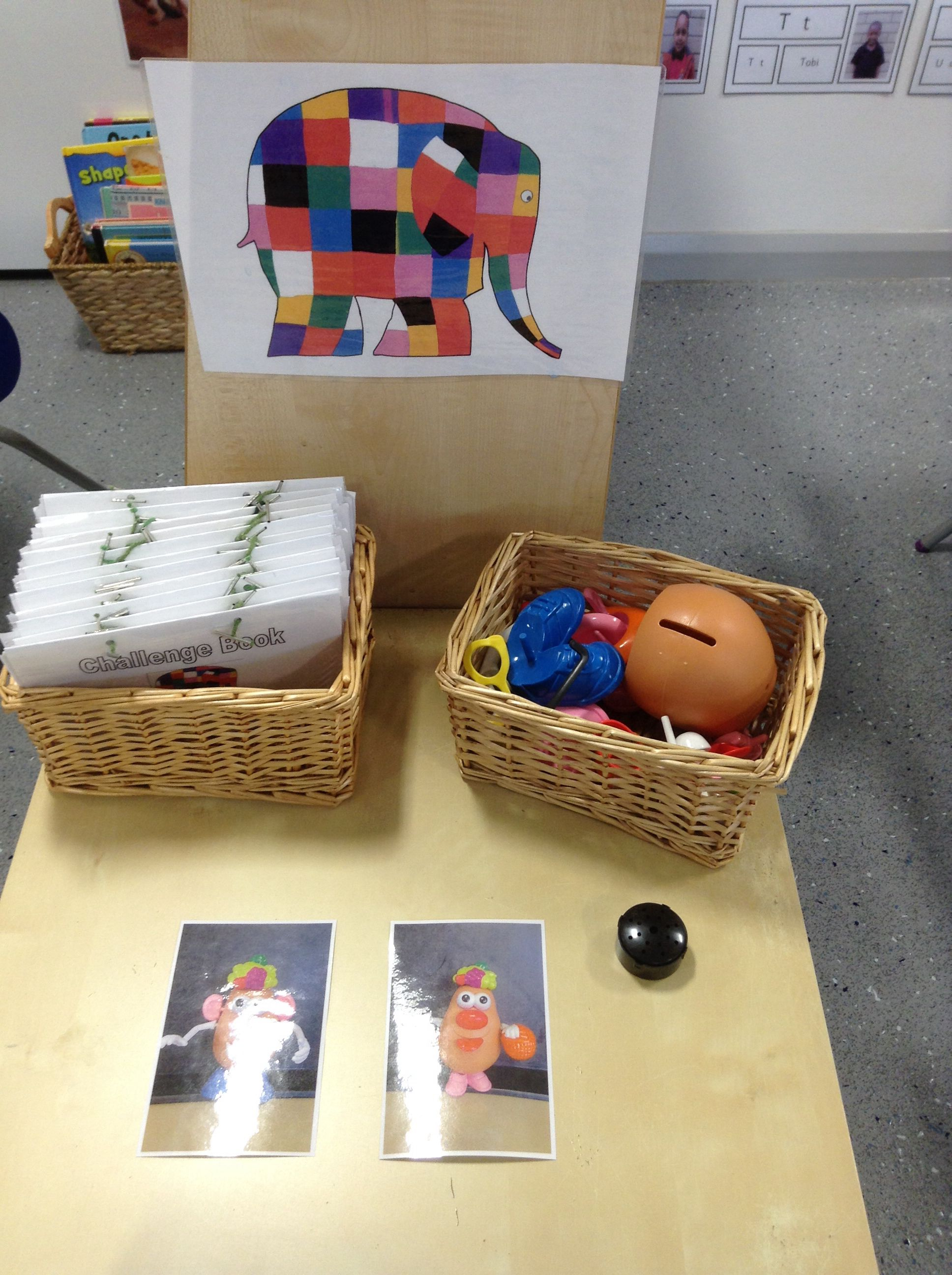 Small challenge table, where children find their personal challenge book and complete a different challenge each day.   This one is to replicate the photos of Mr Potato Head!