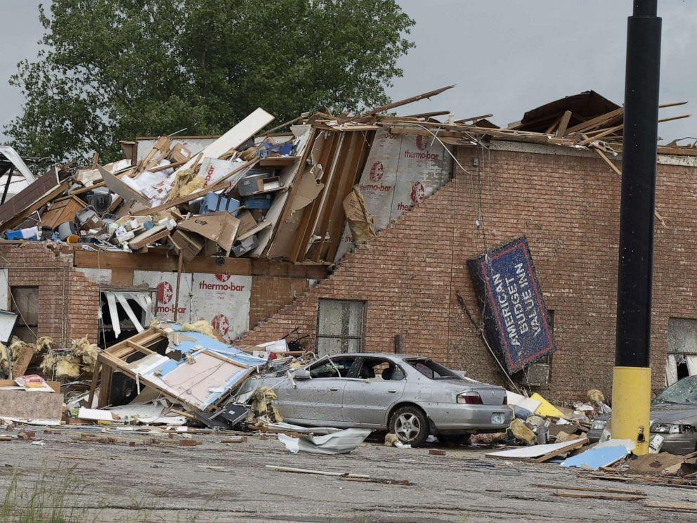 2 dead, 29 hurt as tornado destroys hotel, trailer park in