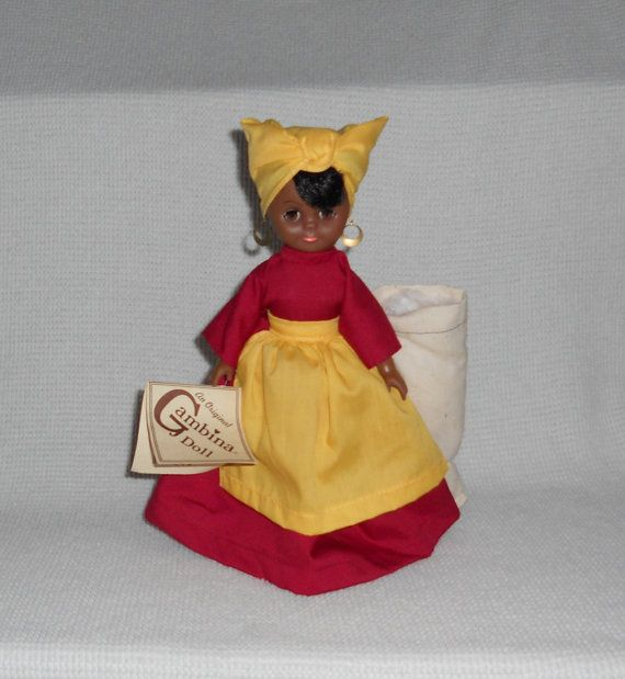 Gambina Nola Cotton Field Worker Black by CollectiveBargains | Yellow  apron, Cotton fields, Doll stands