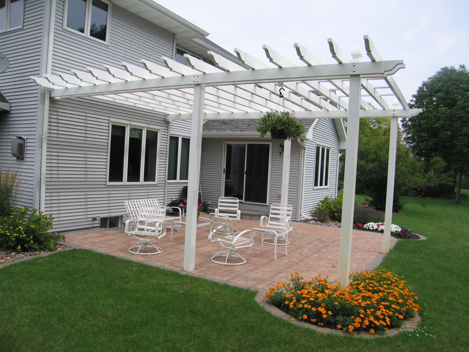 Large white pergola off of the back of a house for a backyard entertainment space the vande hey - Houses large patios ...