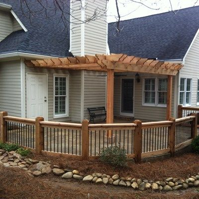 Cedar Pergola Wred Around The Fireplace Chimney With Curved Railing Metal Baers