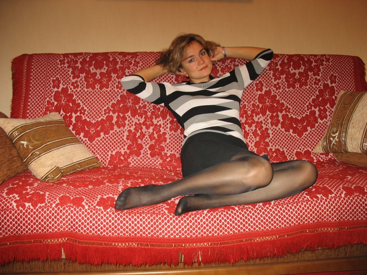 On The Sofa Wearing Black Pantyhose And Beautiful Nylon