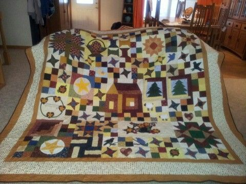 BOM in a Month  Malear's Sullivan MO  This quilt has a down home scrappy feel.  There are stars' cabin, hearts, pine tree, lambs, birds and a whole bunch of other quilt blocks.