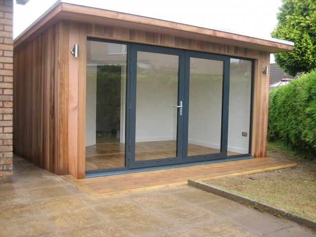 Bespoke 27 m2 contemporary studio with overhanging roof for Wooden garden rooms extensions