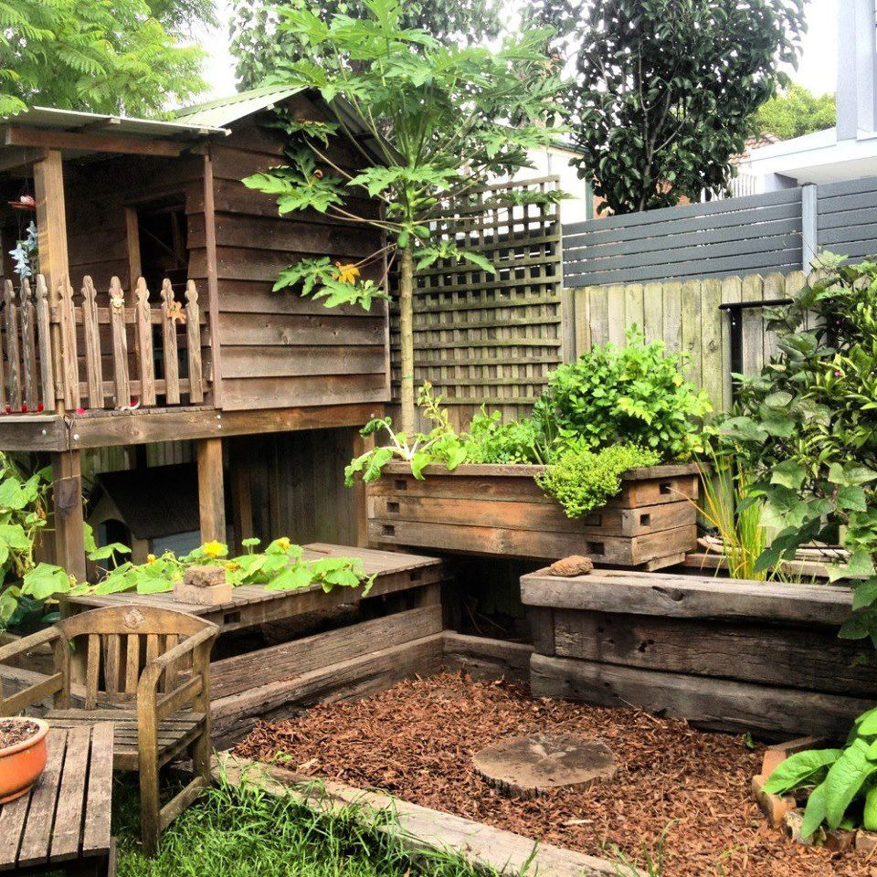 Lovely Outdoor Living Area With Raised Veggie Gardens....I Like It.