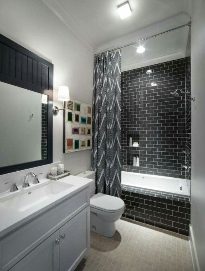 Black rectangular tiles in shower.  Nice modern design