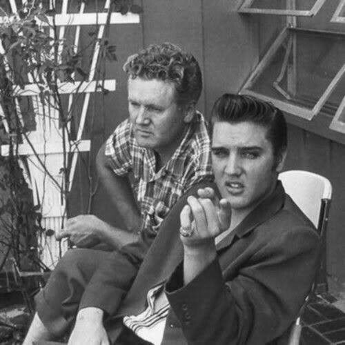 """Elvis and his father, Vernon Presley photographed on the patio of their 1034 Audubon Drive home in Memphis, TN by journalist Lloyd Shearer - late July 1956. Shearer was on assignment for """"Parade"""" magazine."""