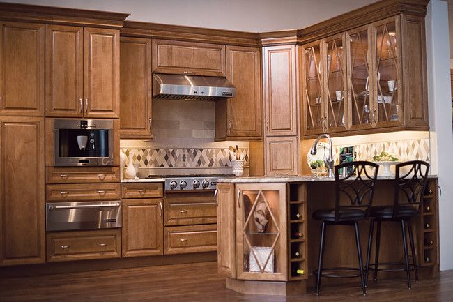 Kitchen Remodel Pictures Maple Cabinets praline maple cabinets are highlightedglass doors and wine