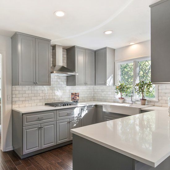 Gray shaker cabinets, white quartz counter tops, Grecian