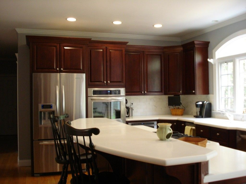Image result for white quartz cherry cabinets gray walls White cabinets grey walls