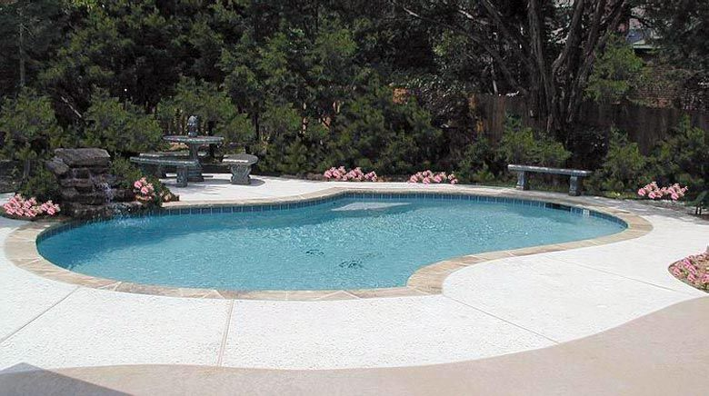 Freeform Pool With Marble White Plaster, Flagstone Coping, And Pea Gravel  Deck
