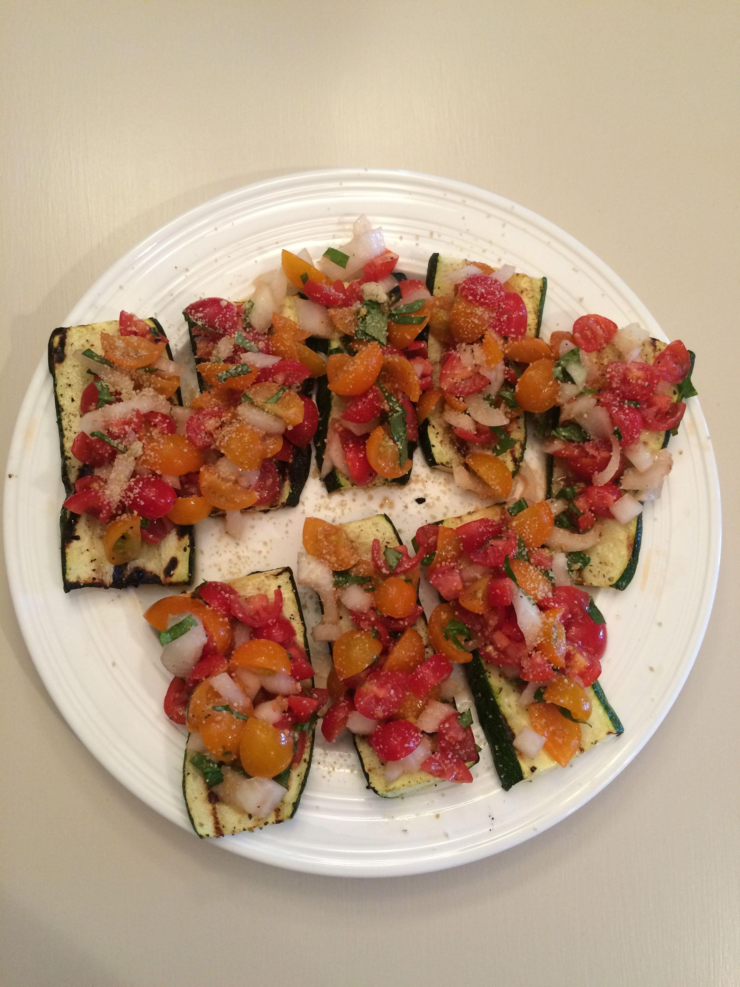 Vegan Zucchini bruschetta  Grill zucchini, top with chopped cherry tomatoes,onion, garlic,1tspn EVO, lemon pepper, fresh basil