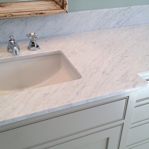 Carrara Marble Countertops Pair With A Polished Chrome Hot And Cold Faucet And Undermount Marble Countertops Carrara Marble Countertop Carrara Marble Bathroom