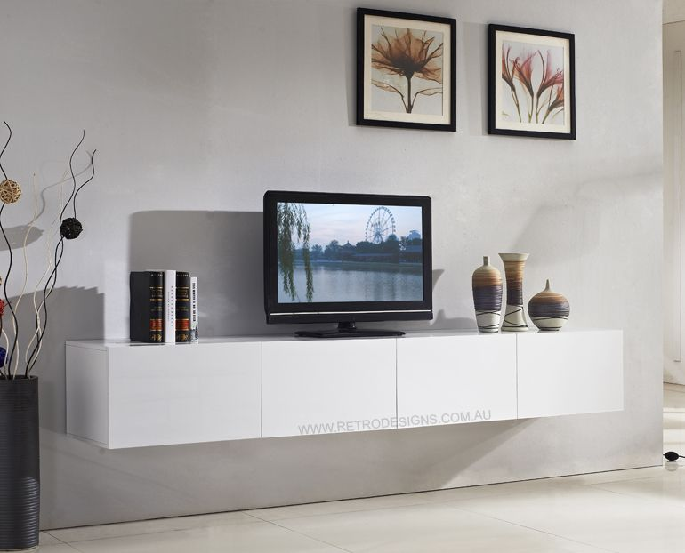 Style your home with floating cabinets living room majeston white floating tv cabinet living for Floating tv stand living room furniture