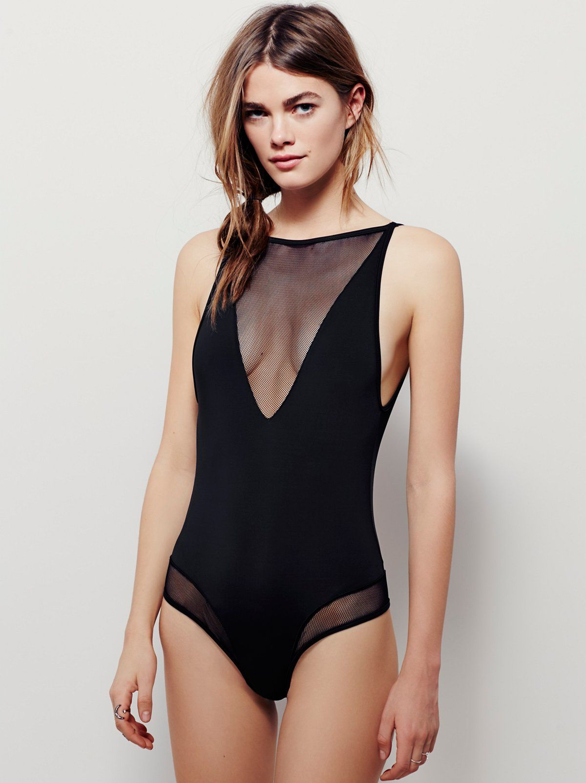 Lara Mesh Bodysuit | American made silky bodysuit featuring mesh trim with a V-neckline and a cheeky fit. Low open back. Adjustable straps.