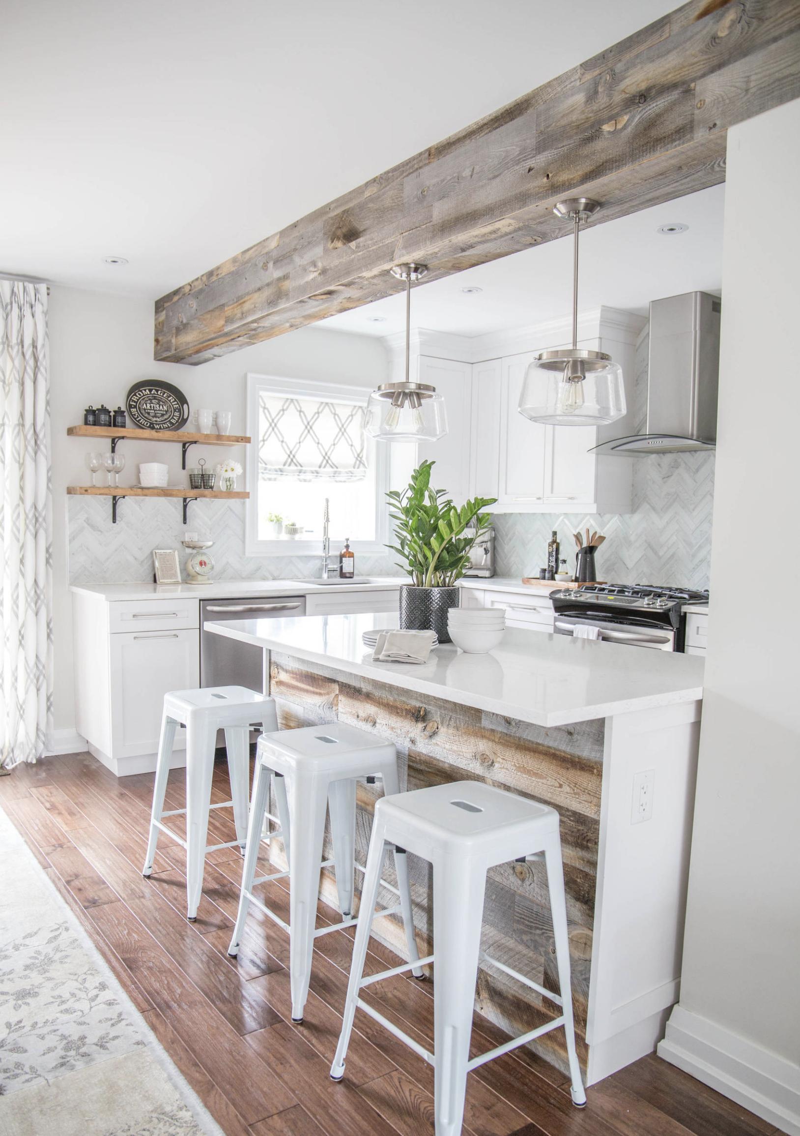 Küchenideen für weiße schränke use a rustic wooden beam to define the space between the kitchen and
