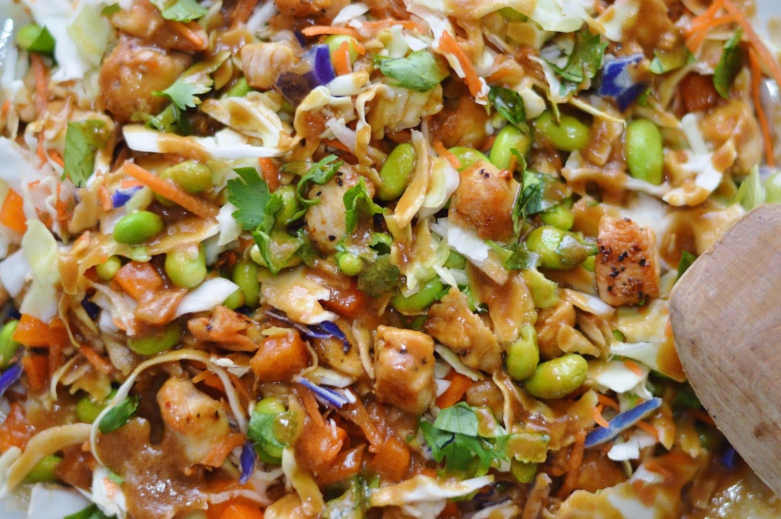 Asian Chopped Chicken Salad with Peanut Dressing  1 (16 oz) bag of coleslaw mix 1 cup cooked chicken 1/2 cup chopped bell pepper (any color) 1/2 cup cooked edamame 1/4 cup chopped fresh cilantro  For the dressing 1 tablespoon creamy natural peanut butter 2 tablespoons honey 2 tablespoons soy sauce 2 tablespoons rice vinegar 1/2 teaspoon sesame oil (or more to taste) 1 tablespoon olive oil