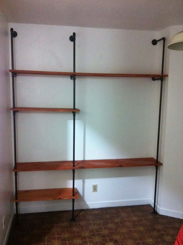How to build a plumbing pipe shelving wall unit easy diy for Easy way to make shelves