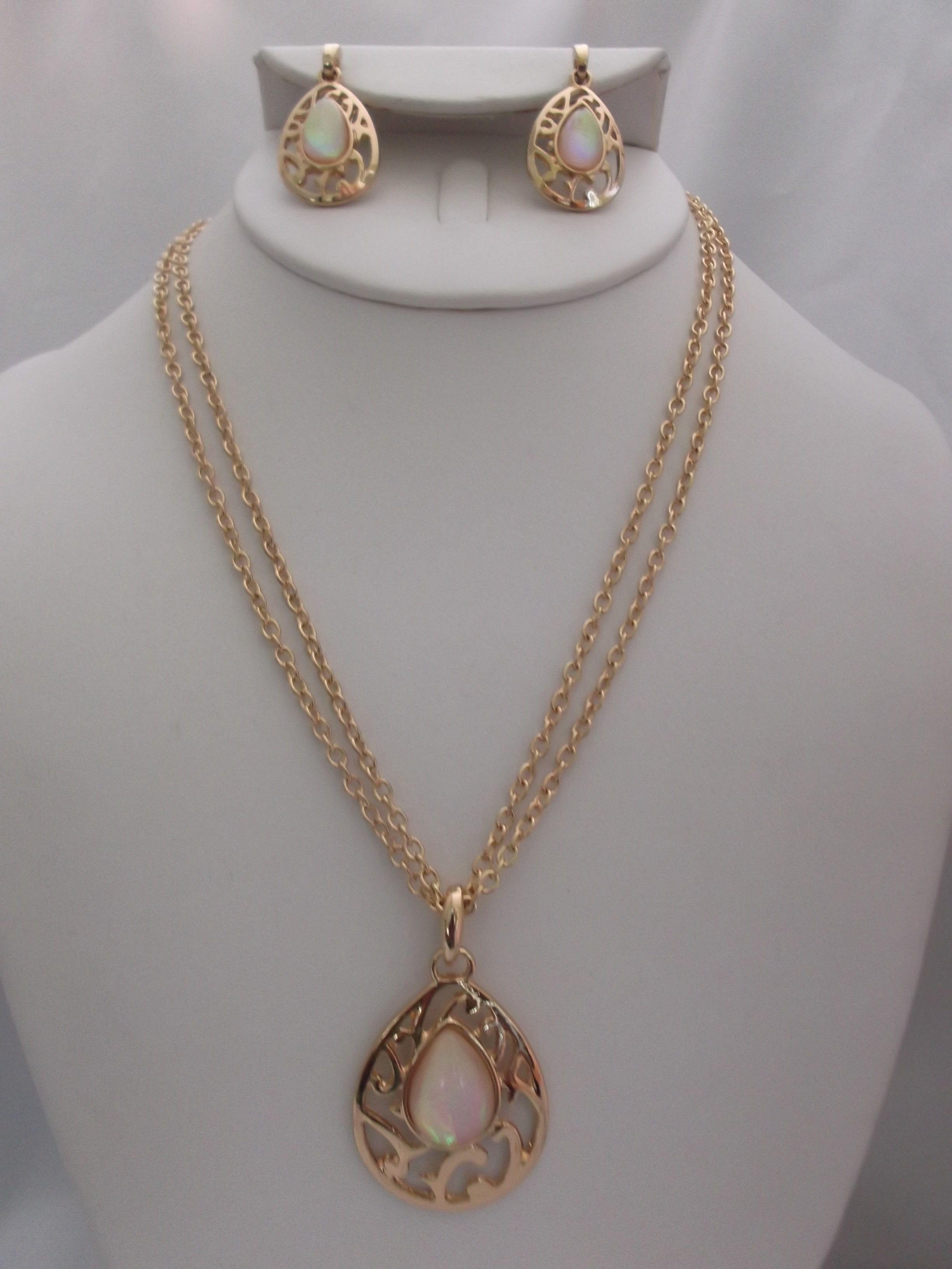 Pierced gold multi chain teardrop white fluorescent stone pendant