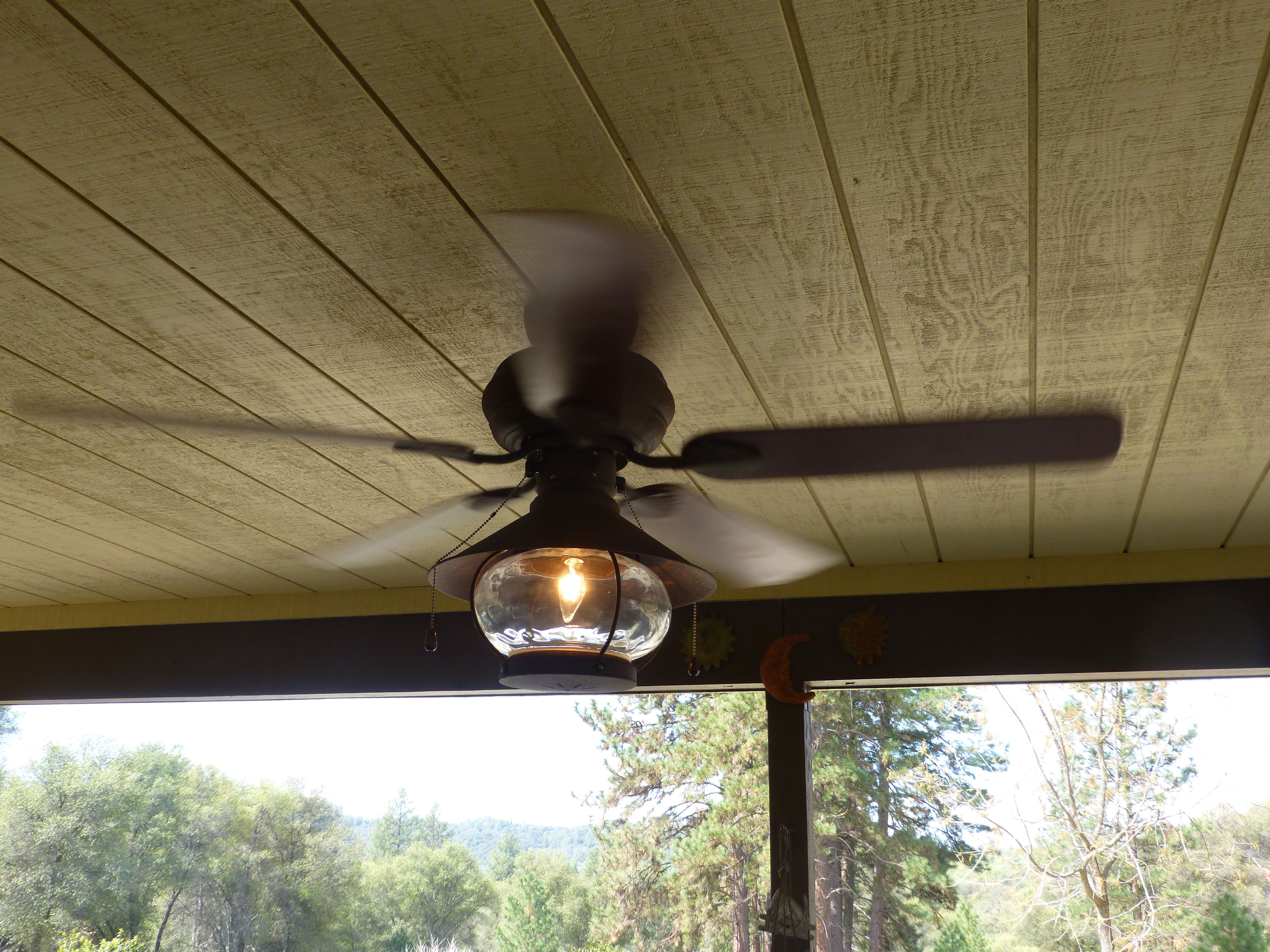 Day 25 The new outside porch ceiling fan lit and spinning