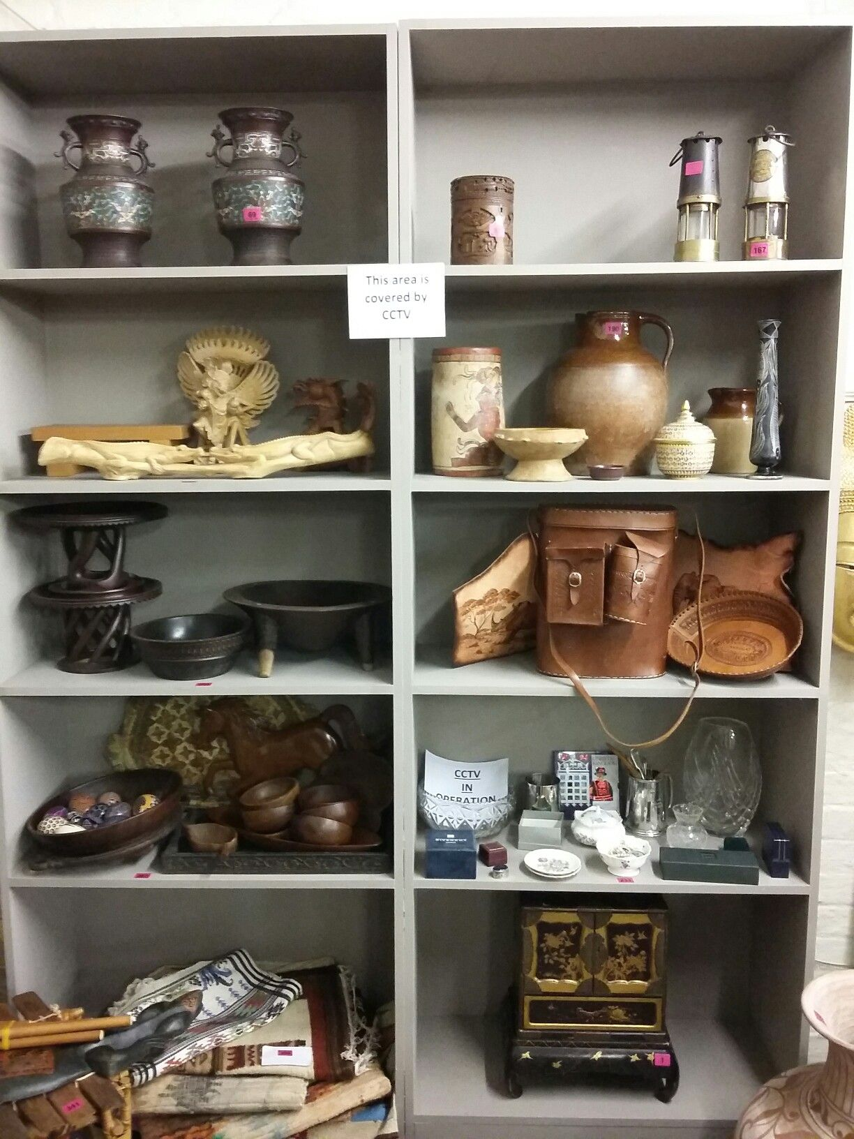 A mixed lot of carved animals, Fijian coconut bowls and two leather gourd bottles to include a Moose bone carving of a lizard, snake and frog group Sold £220