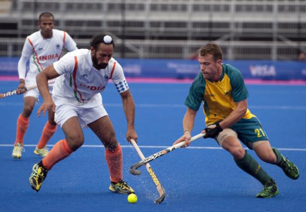 India S Sardar Singh L Vies Against Australia S Glenn Simpson