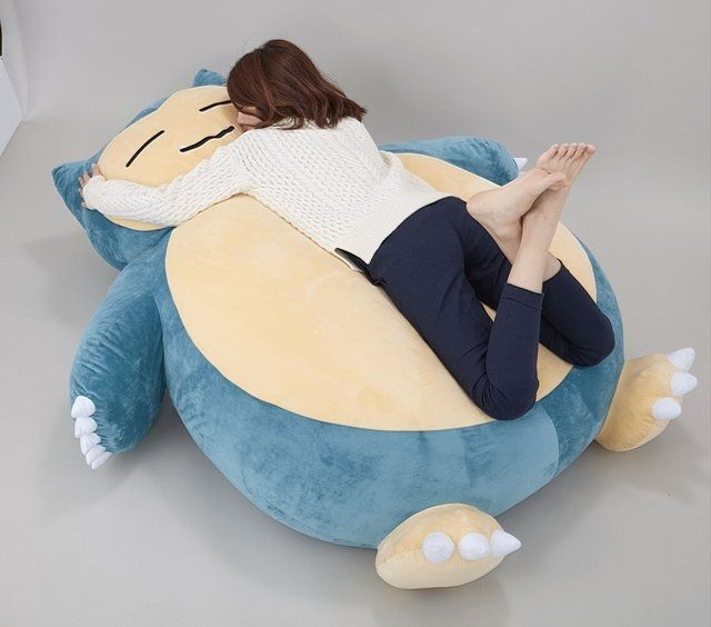The Pokémon franchise just turned twenty (it's officially February 27th in Japan), and what longtime Pokémon fan hasn't dreamed of sleeping on an enormous Snorlax plushie? Well your dreams will soon be reality, as Bandai is planning to sell exactly...